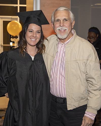 A daughter and dad at graduation